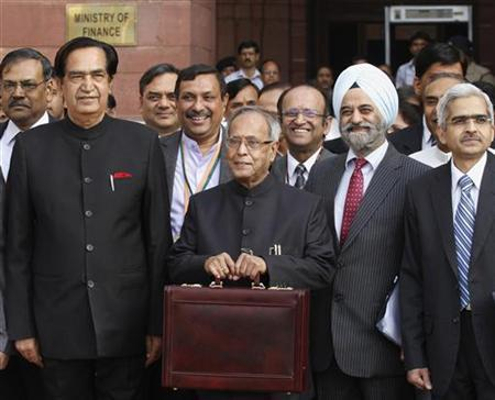 Finance Minister Pranab Mukherjee (2nd L) poses as he leaves his office to present the 2012/13 federal budget in New Delhi March 16, 2012. REUTERS/Vijay Mathur