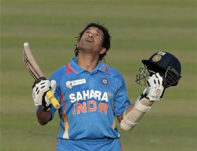 India's Sachin Tendulkar celebrates after he scored his 100th international centuries during their Asia Cup One Day International (ODI) cricket match against Bangladesh in Dhaka March 16, 2012. REUTERS/Andrew Biraj