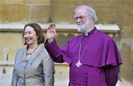 Britain's Archbishop of Canterbury Rowan Williams (R) and his wife Jane wave to Queen Elizabeth and Prince Philip after a Diamond Jubilee multi-faith reception at Lambeth Palace in central London February 15, 2012. REUTERS/Toby Melville