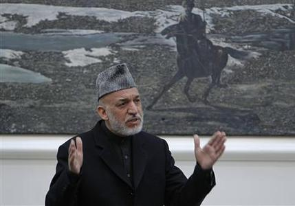 Afghanistan's President Hamid Karzai speaks during a meeting with the family members of civilians killed by U.S. soldier in Kandahar last week at the presidential palace in Kabul March, 16, 2012.REUTERS/Omar Sobhani