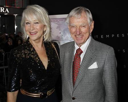 Actress Helen Mirren (L) poses with David Murdock, chairman of Dole Food, at the premiere of her film 'The Tempest' in Hollywood December 6, 2010. REUTERS/Fred Prouser