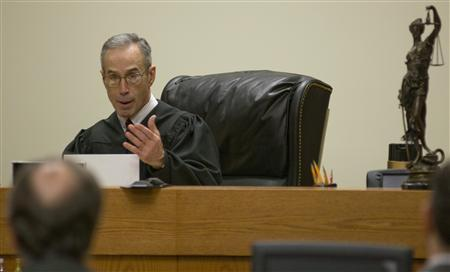 Judge Glenn J. Berman addresses the jury before they begin deliberations in the case of Dharun Ravi, a Rutgers University student charged with bias intimidation, with his team of attorneys in the Superior Court of New Jersey in Middlesex County for jury selection, New Brunswick, March 14, 2012. REUTERS- Mark Dye