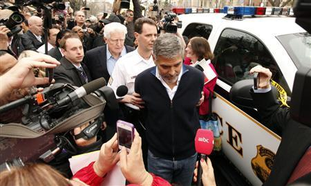 Actor George Clooney is arrested for civil disobedience after protesting at the Sudan Embassy in Washington March 16, 2012. Clooney was protesting the escalating humanitarian crisis in Sudan. REUTERS/Kevin Lamarque
