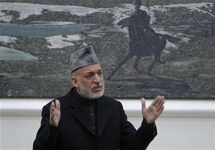 Afghanistan's President Hamid Karzai speaks during a meeting with the family members of civilians killed by U.S. soldier in Kandahar last week at the presidential palace in Kabul March, 16, 2012. REUTERS/Omar Sobhani