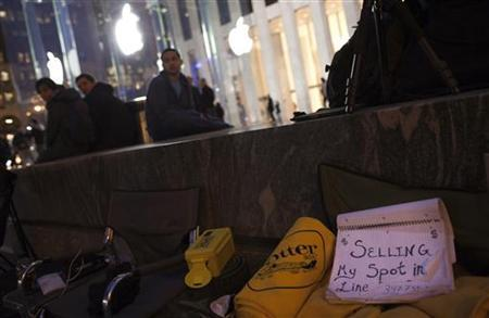A sign advertises a spot for sale where people camp out on Fifth Avenue in New York outside Apple's Fifth Avenue Store to reserve spots for Apple's new iPad due for March 16 release March 15, 2012. REUTERS/Andrew Kelly