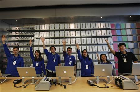 Staff await customers at an Apple store in Hong Kong March 16, 2012. The Apple branch in Hong Kong was the first in the region to open for online orders to avoid queuing confusion. REUTERS/Tyrone Siu