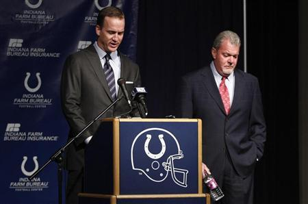Indianapolis Colts quarterback Peyton Manning (L) tips his head down while answering a question while standing beside Colts owner and CEO Jim Irsay during a press conference where Irsay announced Manning's release from the team after 14 seasons, in Indianapolis March 7, 2012. REUTERS/Brent Smith