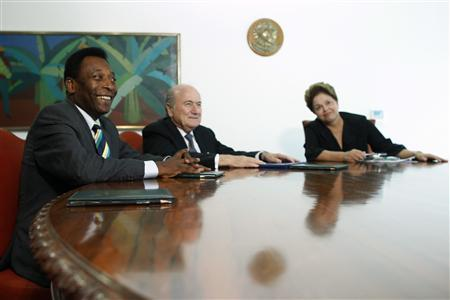 Brazil's President Dilma Rousseff (R) attends a meeting with International Federation of Football Association (FIFA) President Sepp Blatter and Brazil's soccer legend Pele (L) at the Planalto Palace in Brasilia March 16, 2012. REUTERS/Ueslei Marcelino