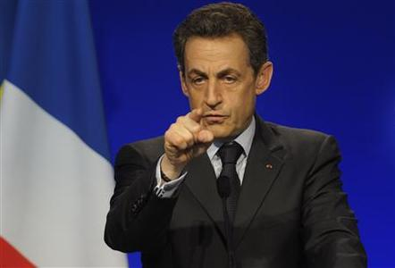 Nicolas Sarkozy, France's President and UMP party candidate for the 2012 French presidential election, delivers a speech at a political rally in Meaux, East of Paris, March 16, 2012. Campaign slogan reads, ''A Strong France''. REUTERS/Philippe Wojazer