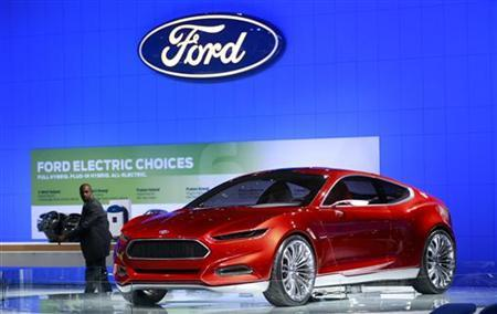 A man passes the Ford Evos concept car at the Washington Auto Show January 27, 2012. REUTERS/Kevin Lamarque