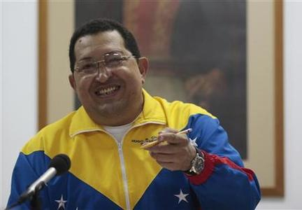 Venezuela's President Hugo Chavez smiles during a Council of Ministers meeting in La Habana March 11, 2012. REUTERS/Miraflores Palace/Handout