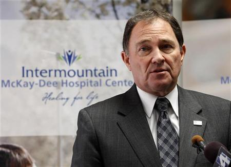 Utah Governor Gary Herbert talks to the media about the shooting death of a police officer and the shooting of five other officers during a drug raid, at McKay-Dee Hospital in Ogden, Utah January 5, 2012. REUTERS/George Frey
