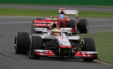 McLaren Formula One driver Lewis Hamilton of Britain drives ahead of Ferrari Formula One driver Fernando Alonso of Spain during the second practice session of the Australian F1 Grand Prix at the Albert Park circuit in Melbourne March 16, 2012. REUTERS/Scott Wensley