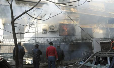Syrian security officials inspect a damaged building near the intelligence centre building, in Damascus in this handout photo distributed by the Syrian News Agency (SANA) March 17, 2012. REUTERS/SANA/Handout