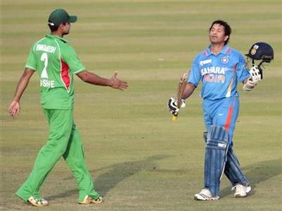 Bangladesh's Masrafe Bin Mortaza (L) congratulates Sachin Tendulkar after he scored his 100th centuries during their One Day International (ODI) cricket match of Asia Cup in Dhaka March 16, 2012. REUTERS/Andrew Biraj