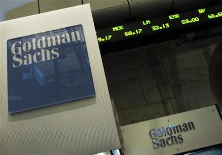 A Goldman Sachs sign is seen over their kiosk on the floor of the New York Stock Exchange, April 26, 2010. REUTERS/Brendan McDermid/Files