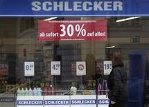 A woman enters a branch of drugstore chain Schlecker, which is offering a discount of 30 percent, in Berlin March 14, 2012. REUTERS/Tobias Schwarz