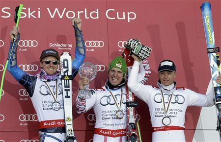 Ted Ligety of the U.S., Austria's Marcel Hirscher, and Massimiliano Blardone of Italy (L-R) celebrate on the winners podium for the men's Giant Slalom event during the alpine ski World Cup finals in Schladming March 17, 2012. REUTERS/Leonhard Foeger