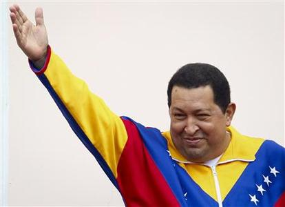 Venezuela's President Hugo Chavez waves to supporters as he attends a ceremony at Miraflores Palace in Caracas March 17, 2012. Chavez flew home on Friday after cancer surgery in Cuba, vowing to conquer the illness and win an October presidential election despite the need for radiation treatment. REUTERS/Carlos Garcia Rawlins