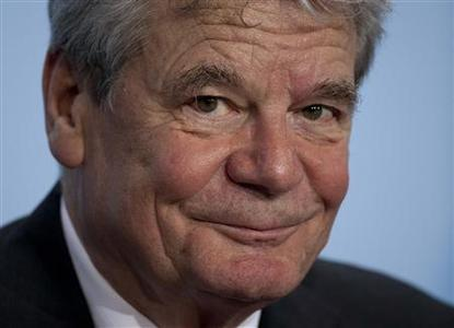 File photo of former East German rights activist Joachim Gauck, the joint candidate of the government and opposition for the post of president, attending a news briefing at the Chancellery in Berlin February 19, 2012. Angela Merkel has dominated the German landscape for over half a decade, outmaneuvering and outshining would-be rivals to become the most popular political figure in the country. After the election of Joachim Gauck to the post of president, however, the German chancellor may find herself sharing the spotlight with a man whose popularity rivals her own and whose willingness to speak his mind could make her life a little less comfortable. TO GO WITH STORY GERMANY-PRESIDENT/MERKEL REUTERS/Thomas Peter/Files