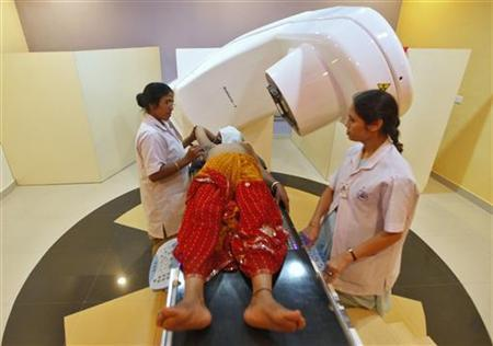 A nurse prepares a breast cancer patient before a Gama-ray test at the Cancer Centre Welfare Home and Research Institute in Kolkata March 16, 2012. REUTERS/Rupak De Chowdhuri