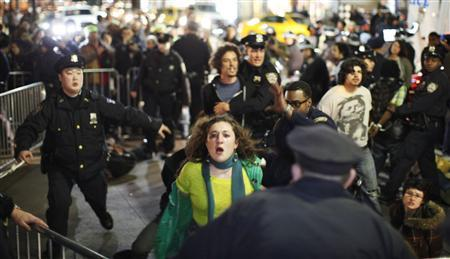 Members of the Occupy Wall St movement are arrested by NYPD officers after protesting at Zuccotti park in New York March 17, 2012. REUTERS/Eduardo Munoz
