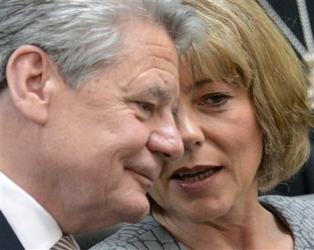 German presidential candidate Joachim Gauck and his partner Daniela Schadt chat during Germany's Federal Assembly in Berlin, March 18, 2012. REUTERS/Fabian Bimmer