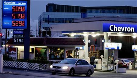 Gasoline is priced over $5 per gallon at a Chevron gasoline station in downtown Los Angeles, California March 13, 2012. Sales at gasoline stations surged 3.3 percent to a record $46.9 billion in January - a figure that reflects higher gasoline costs. The percentage gain was the largest since March last year and followed a 1.9 percent increase in January 2012. REUTERS/Fred Prouser
