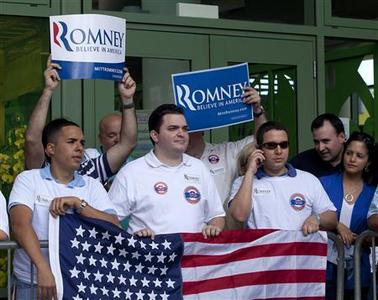 Supporters of U.S. Republican presidential candidate and former Massachusetts Governor Mitt Romney wait outside a market place to greet him on his last day of a two day campaign visit in Bayamon March 17, 2012. REUTERS/Ana Martinez