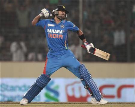 Virat Kohli celebrates after scoring a century against Pakistan during their Asia Cup One Day International cricket match in Dhaka March 18, 2012. REUTERS/Andrew Biraj