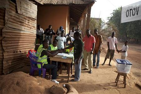 People register to vote in Bissau, Guinea-Bissau, March 18, 2012. REUTERS/Joe Penney/Files