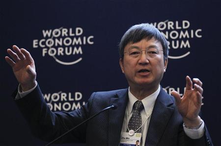 Min Zhu, Deputy Managing Director, International Monetary Fund (IMF), attends a session at the World Economic Forum (WEF) in Davos, January 26, 2012. REUTERS/Arnd Wiegmann