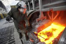 A worker operates an electrolysis furnace, which produces aluminium from raw materials, at the electrolysis shop of the Rusal Krasnoyarsk aluminium smelter plant in the Siberian city of Krasnoyarsk in this February 3, 2010 file photo. REUTERS/Ilya Naymushin/Files