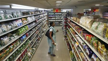 A customer looks at consumable goods before buying them at a supermarket in Hyderabad December 1, 2011. REUTERS/Krishnendu Halder/Files