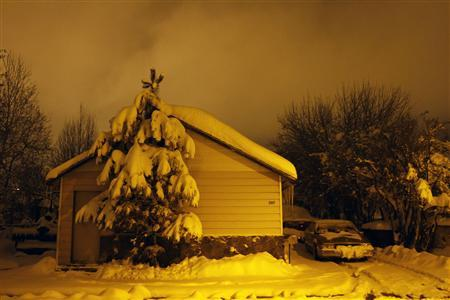 Several inches of snow cover a house and its surroundings in Flagstaff, Arizona, March 18, 2012. REUTERS/Joshua Lott