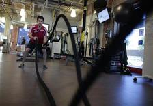 Performance specialist David Delgado, 27, demonstrates a rope exercise in the company gym which is open 24 hours a day at the Google campus near Venice Beach, in Los Angeles, California January 13, 2012. The 100,000 square-foot campus was designed by architect Frank Gehry, and includes an entrance through an iconic pair of giant binoculars designed by Claes Oldenburg and Coosje van Bruggen. Around 500 employees develop video advertising for YouTube, parts of the Google+ social network and the Chrome Web browser at the site. REUTERS/Lucy Nicholson