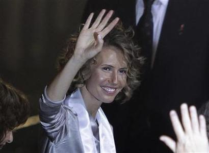 Syria's First Lady Asma al-Assad waves as she attends the opening ceremony for the 7th Special Olympics Middle East/North Africa (SOMENA) Regional Games in Damascus September 25, 2010. REUTERS/ Khaled al-Hariri