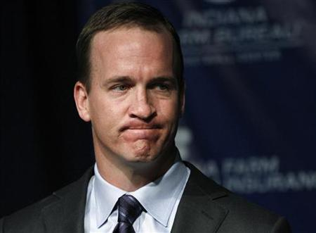 Indianapolis Colts quarterback Peyton Manning reacts during a press conference where Colts owner and CEO Jim Irsay announced Manning's release from the team after 14 seasons, in Indianapolis March 7, 2012. REUTERS/Brent Smith