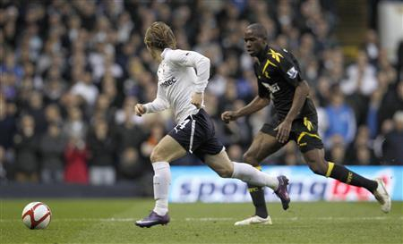 Tottenham Hotspur's Luka Modric (L) runs with the ball next to Bolton Wanderers' Fabrice Muamba during their English FA Cup quarter-final soccer match at White Hart Lane, in London March 17, 2012. REUTERS/Suzanne Plunkett