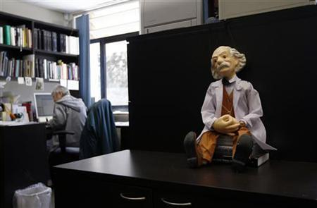 A doll of Albert Einstein is displayed in an office at the Hebrew University in Jerusalem March 19, 2012. REUTERS/Ronen Zvulun