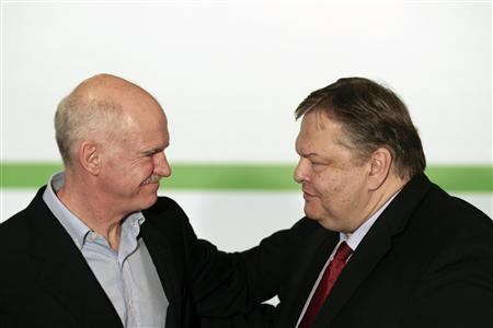 Greece's Finance Minister and new leader of the PASOK Socialist party Evangelos Venizelos (R) greets outgoing leader George Papandreou in Athens March 19, 2012. REUTERS/Yorgos Karahalis