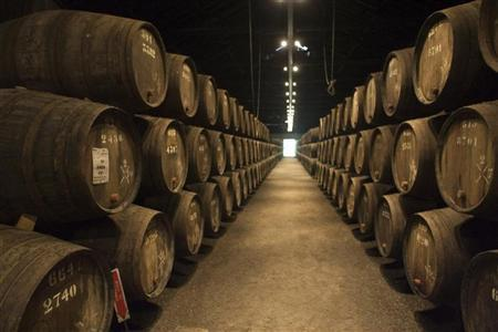 Barrels of aged Port wine are seen at a Gaia city cellar in northern Portugal September 11, 2006. REUTERS/Jose Manuel Ribeiro