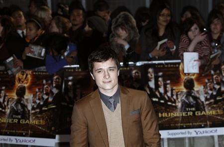 Actor Josh Hutcherson poses for photographers as he arrives for the European premiere of ''The Hunger Games'' at the O2 Arena in London March 14, 2012. REUTERS/Luke MacGregor