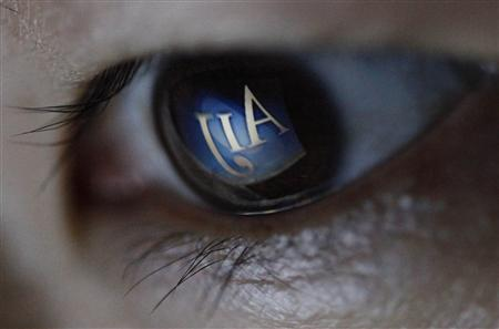 The logo of AIJ Investment Advisors Co is reflected in an eye in this photo illustration taken in Tokyo March 7, 2012. REUTERS/Toru Hanai