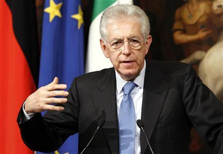 Italian Prime Minister Mario Monti gestures during a news conference with German Chancellor Angela Merkel at Chigi palace in Rome March 13, 2012. REUTERS/Tony Gentile