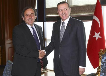 Turkey's Prime Minister Recep Tayyip Erdogan shakes hands with UEFA President Michel Platini (L) before a meeting in Ankara March 19, 2012. REUTERS/Adem Altan