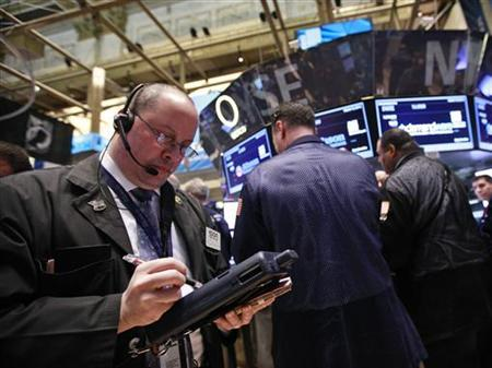 Traders work on the floor of the New York Stock Exchange March 15, 2012. REUTERS/Brendan McDermid