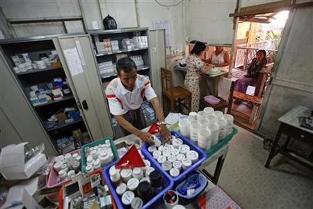 Pharmacists prepare medicine for two HIV-positive patients at Medecins Sans Frontieres-Holland (AZG)'s clinic in Yangon February 21, 2012. REUTERS/Soe Zeya Tun