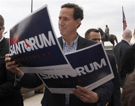 Republican presidential candidate and former U.S. Senator Rick Santorum signs posters at a ''Rally for Rick'' campaign stop in Dixon, Illinois, March 19, 2012. REUTERS/Jeff Haynes