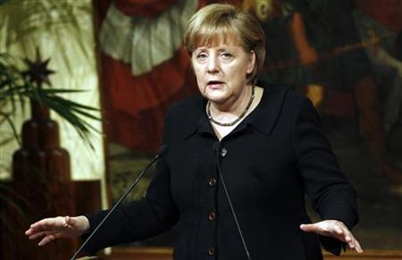 German chancellor Angela Merkel speaks during a news conference with Italian Prime Minister Mario Monti at Chigi Palace in Rome March 13, 2012. REUTERS/Tony Gentile